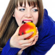 Woman eating red apple — Stock Photo