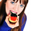 Girl eating caviar — Stock Photo