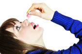 Injecting drops into the nose — Stock Photo