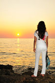 Girl at sunset time — Stock Photo