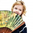 Little girl holding big fan — Stock Photo