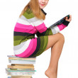 Sweet teen on the pile of books — Stock Photo #2939890