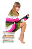 Sweet teen on the pile of books — Stock Photo
