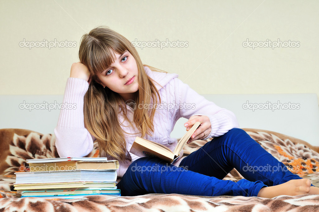 Bored girl with books doing her homework — Stock Photo #2939944