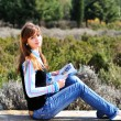 Foto de Stock  : Teen girl reading magazine