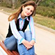 Teen girl resting in the park — Stock Photo