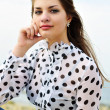 Girl wearing spotted blouse — Stock Photo
