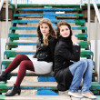 Girls sitting on the stairs — Stock Photo