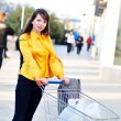 Stock Photo: Girl with shopping trolley
