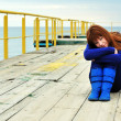Redheaded girl on a pier — Stock Photo