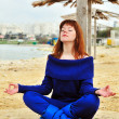 Meditation on the beach — Stock Photo