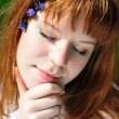 Face of redheaded girl in spring forest — Stock Photo