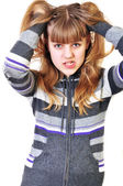 Angry teen disarranging her hair — Stock Photo