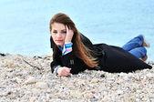 Girl on the pebble — Stock Photo