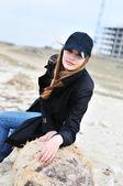 Girl sitting on the log — Stock Photo