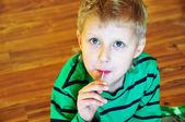 Cute little boy with lollipop — Stock Photo