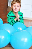 Boy with blue balloons — Stock Photo
