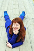 Redheaded girl wearing blue clothes — Stock Photo
