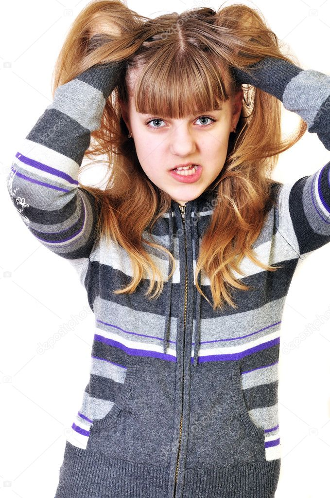 Angry funny teen girl disarranging her  hair — Stock Photo #2940056