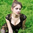 Awesome girl sitting in the high grass — Stock fotografie #3817647