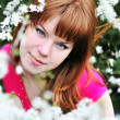 Redheaded girl in blossom — Stock Photo #3817896