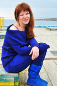 Girl on a pier — Stock Photo
