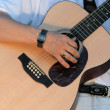 Hand and guitar — Stock Photo