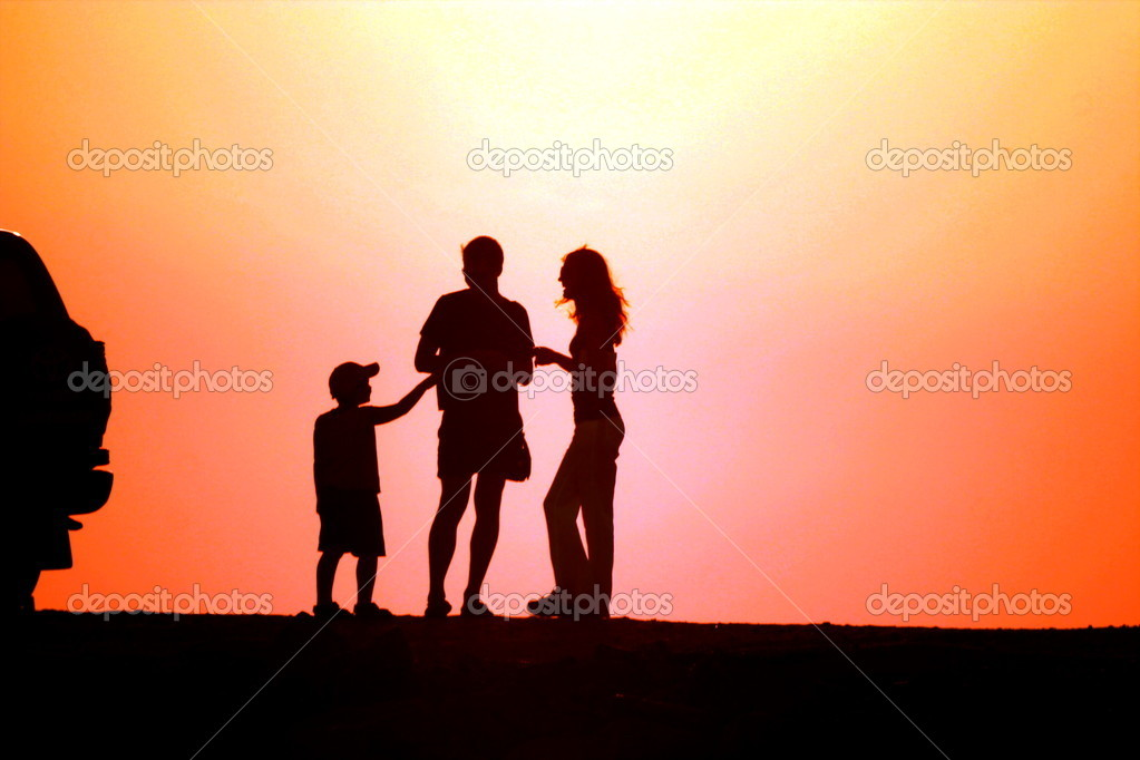 Family with child on sundown background — Stock Photo #2791903
