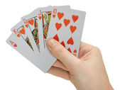 Hand with playing cards — Stock Photo