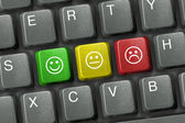 Keyboard close-up with three smiley keys — Stock Photo