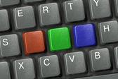 Keyboard with three multicolored keys — Stock Photo
