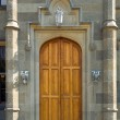 Wooden door in old castle — Stock Photo #3929677