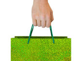 Hand with bag — Stock Photo