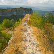 Stock Photo: Pathway and precipice in mountains