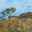 Cross on rock — Stock Photo