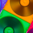 Computer disks in multiciolored boxes — Stock Photo #3982078
