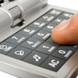 Stock Photo: Hand and calculator