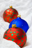 Christmas balls in wrapping paper — Stock Photo