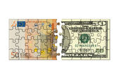 Euro and dollar puzzle — Stock Photo