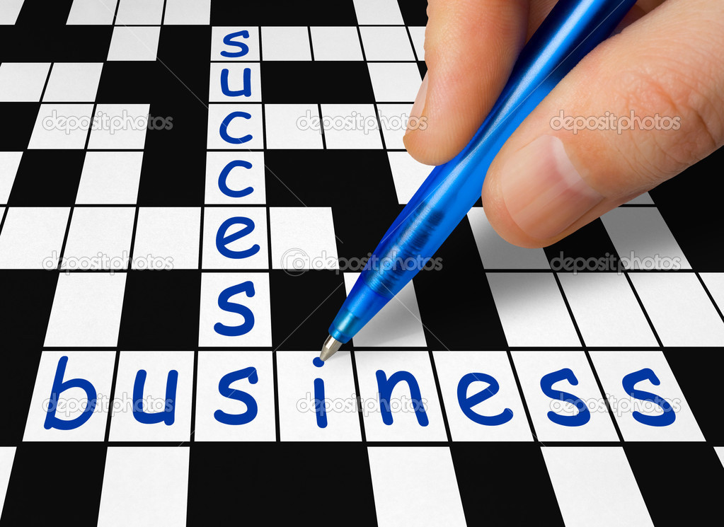 Hand filling in crossword - business and success — Stock Photo #4017933