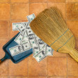 Money and broom — Stock Photo #4030731