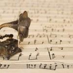 Gramophone on old sheet music — Stock Photo