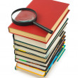 Stack of books and magnifying glass — Stock Photo #4060996