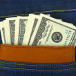 Money and wallet in jeans pocket — Stock Photo