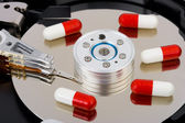 Pills on computer hard drive — Stock Photo