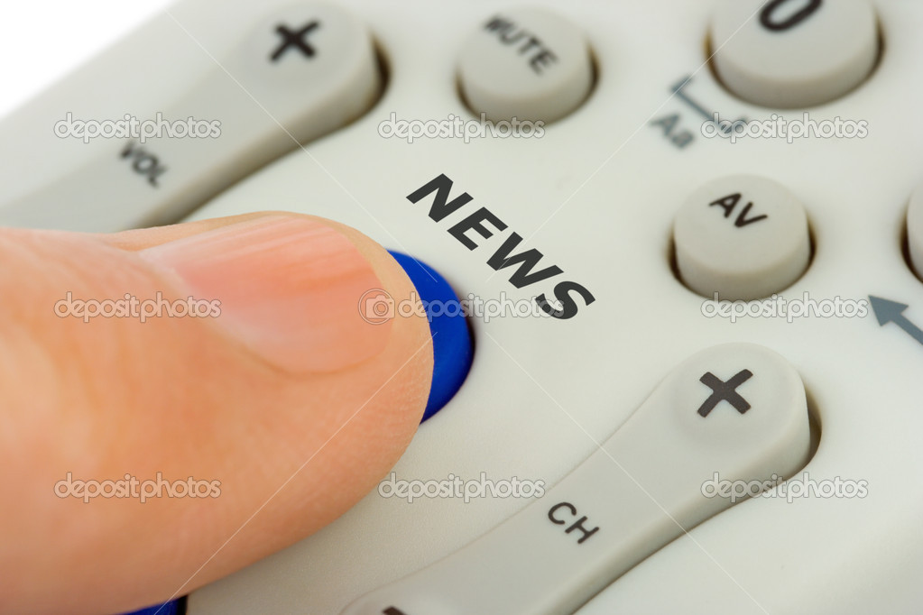 Hand pushing button news on television remote control — Stock Photo #4063897