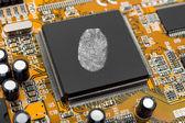 Fingerprint on computer chip — Stock Photo