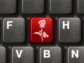 PC keyboard with flower key — Stok fotoğraf
