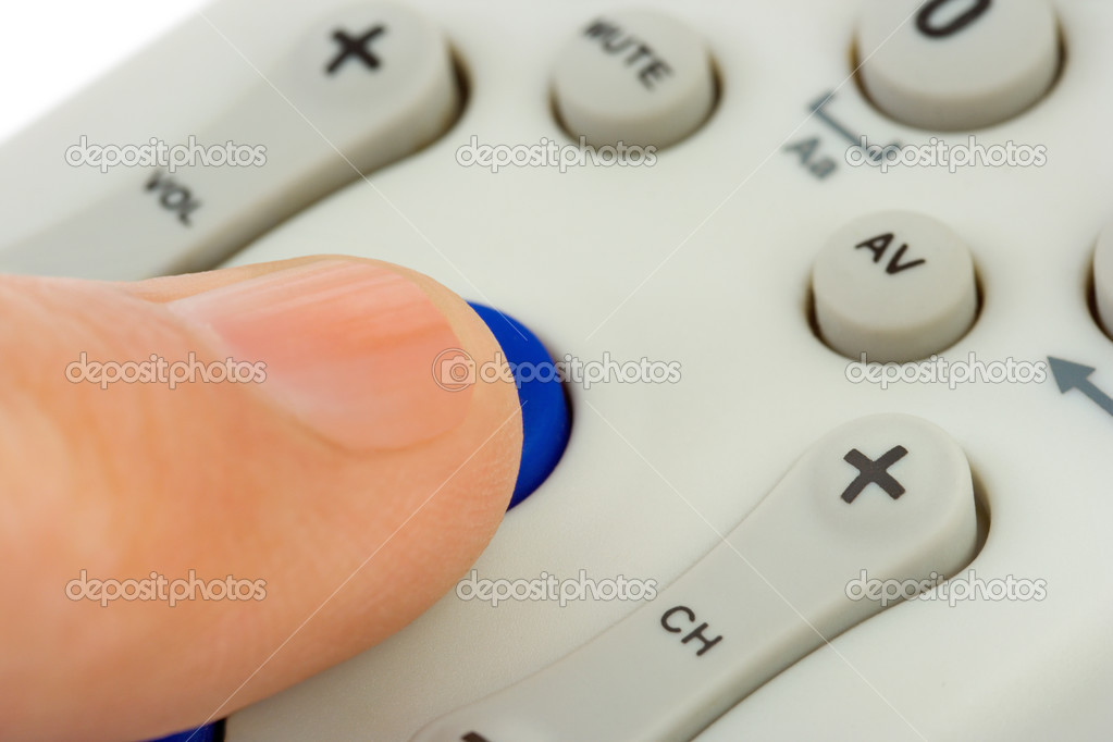 Hand pushing button on television remote control — Stock Photo #4076684