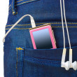 MP3 player in jeans pocket — Stock Photo